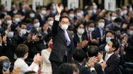 Former Japanese Foreign Minister Fumio Kishida waves as he is elected as new head of the ruling party in the Liberal Democratic Party
