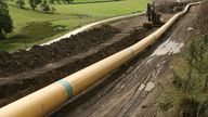 An engineer walks along a stretch of pipeline near Skipton in northern England August 21, 2006.