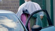 Katie Price, covered with a blanket, leaves Crawley Magistrates' Court, West Sussex, where she pleaded guilty to drink driving, driving whilst disqualified and driving without insurance following a crash near her home in Sussex on Tuesday. Picture date: Wednesday September 29, 2021.