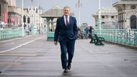 Labour leader Sir Keir Starmer walks along Brighton seafront promenade during the Labour Party conference in Brighton. Picture date: Tuesday September 28, 2021.