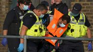 A group of people thought to be migrants are brought in to Dover, Kent, by Border Force officers, following a small boat incident in the Channel. Picture date: Thursday September 16, 2021.