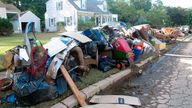 This Sept. 3, 2021 photo shows ruined household possessions at the curb in Manville N.J. two days after the remnants of Tropical Storm Ida caused massive flooding in the New Jersey town near the Raritan River. (AP Photo/Wayne Parry)