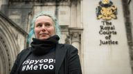 Kate Wilson standing outside the Royal Courts of Justice.