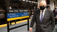 Prime Minister Boris Johnson prepares to board a train from Penn Station in New York to Washington DC