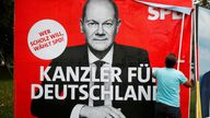 A poster advertising Olaf Scholz's campaign is placed on a bill board in Bonn