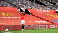 Manchester United's Bruno Fernandes prepares to take a corner in front of empty stands during the Premier League match at Old Trafford, Manchester 24/6/2020
