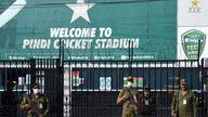 Police officers stand guard outside Rawalpindi Cricket Stadium