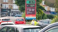 A member of staff directs drivers in a queue for fuel at a closed Sainsbury's petrol station in south London