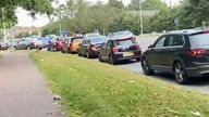 Motorists queue for petrol after being told not to panic buy by the transport secretary