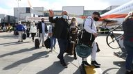 Passengers prepare to board an easyJet flight to Faro, Portugal, at Gatwick Airport in West Sussex after the ban on international leisure travel for people in England was lifted following the further easing of lockdown restrictions.
