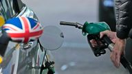A driver fills a car with fuel at a petrol station in London PIC:AP