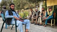 Taliban fighters outside their house
