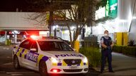 Police stand outside a supermarket in Auckland, New Zealand, Friday,  New Zealand authorities say they shot and killed a violent extremist after he entered the supermarket and stabbed and injured six shoppers. New Zealand Prime Minister Jacinda Ardern described Friday's incident as a terror attack PIC:AP