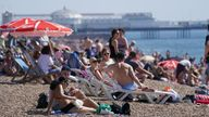 People enjoy the warm weather at Brighton beach in West Sussex. Temperatures are forecast to reach up to 30C in parts of the UK on Tuesday as the country enjoys a warm start to September. Picture date:  September 7,