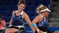 Britain's Jordanne Whiley, left, and Lucy Shuker celebrates after defeating South Africa's Kgothatso Montjane and Mariska Venter in a women's doubles quarterfinal tennis match at the Tokyo 2020 Paralympic Games, Sunday, Aug. 29, 2021, in Tokyo, Japan. (AP Photo/Kiichiro Sato)
