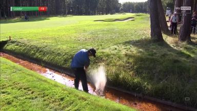Aphibarnrat hits shot from a ditch!