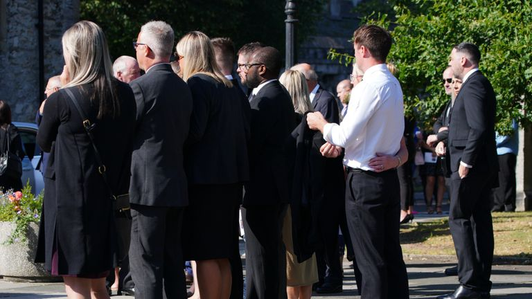 People pay their respects as the cortege leaves the Church of St Andrews, Plymouth, following the funeral of three-year-old Sophie Martyn and her father Lee Martyn, 43, victims of the Plymouth shootings. Picture date: Monday September 6, 2021.