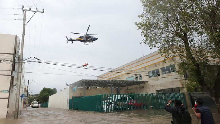 Rescue personnel use a police helicopter to rescue a patient from a flooded hospital after heavy rainfall during Monday's night in the municipality of Tula de Allende, which left people dead, injured and cars and infrastructure damaged, in Tula de Allende, on the outskirts of Mexico City, Mexico September 7, 2021. REUTERS/Henry Romero