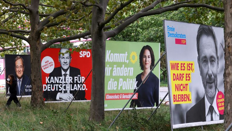 Election posters of Germany's top candidates for chancellor, Armin Laschet, North Rhine-Westphalia's State Premier and Christian Democratic Union (CDU) leader, Olaf Scholz, German Minister of Finance of the Social Democratic Party (SPD), Annalena Baerbock, co-leader of Germany's Green party and Christian Lindner, leader of the Free Democratic Party of Germany (FDP) are pictured, in Berlin, Germany, September 16, 2021. REUTERS/Fabrizio Bensch