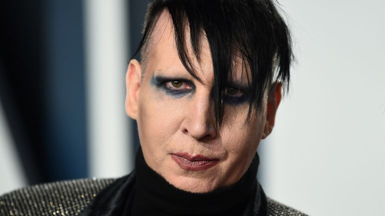 FILE - Marilyn Manson arrives at the Vanity Fair Oscar Party on Feb. 9, 2020, in Beverly Hills, Calif. An attorney has entered a not guilty plea on behalf Manson, who is accused of approaching a videographer at his 2019 concert in New Hampshire and allegedly spitting and blowing his nose on her. A case status hearing is scheduled for Dec. 27. (Photo by Evan Agostini/Invision/AP, File)