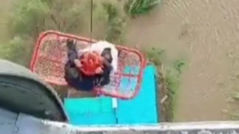 A video released by the Indian Air Force shows people being airlifted from a roof surrounded by flood waters. Three people were rescued in Latur with a further 16 being rescued the day before.