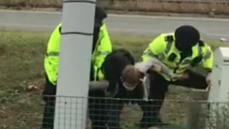 Protesters being detained in Dartford, Kent, near the M25
