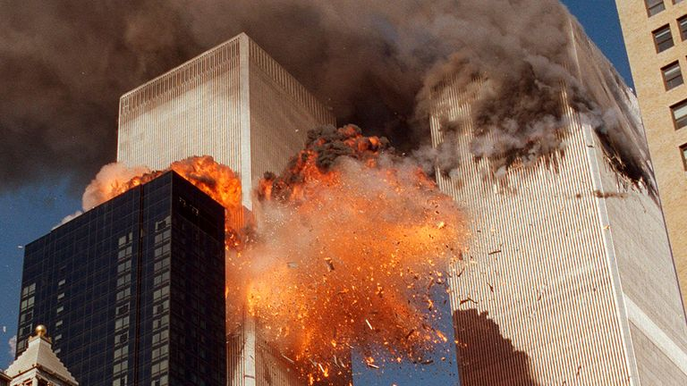 HOLD FOR STORY FILE - In this Sept. 11, 2001, file photo, smoke billows from one of the towers of the World Trade Center and flames as debris explodes from the second tower in New York. Family members of 9/11 families and others harmed in the terrorist attacks are on a fresh quest to hold Saudi Arabia responsible. A magistrate judge presiding over a Thursday, March 23, 2017, hearing says she hopes to streamline the legal process to speed the lawsuits along. (AP Photo/Chao Soi Cheong, File)