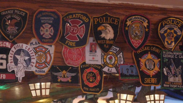 Inside this New York pub, the walls are covered with the badges of the first responders