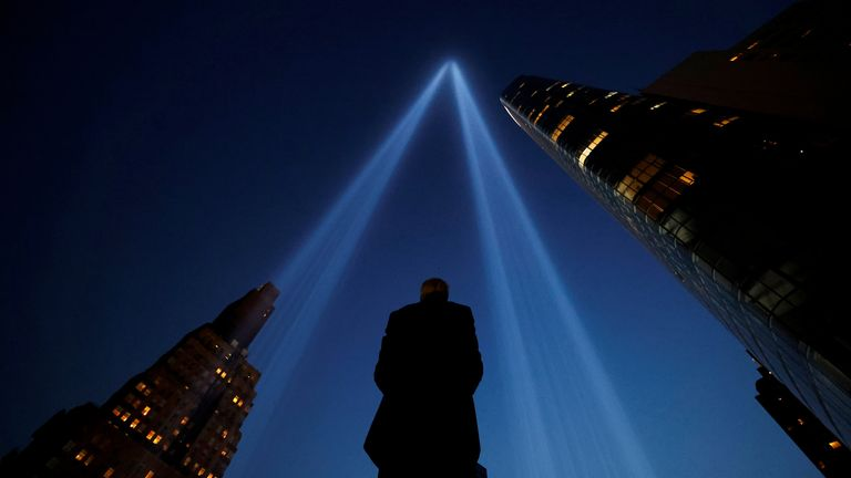 The lights hauntingly mark where the towers once stood