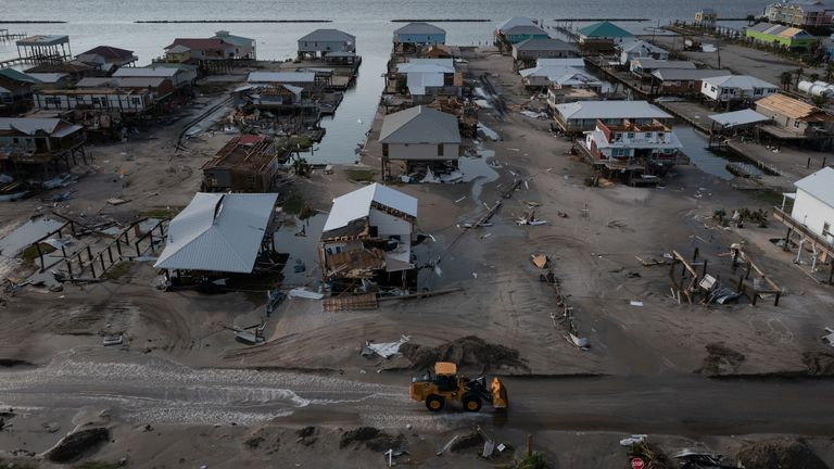 Houses and businesses are seen damaged in the aftermath of Hurricane Ida as the Category 4 hurricane devastated the town and barrier island of Grand Isle, Louisiana