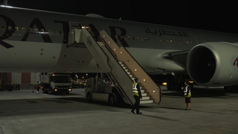 A chartered flight arrives in Doha.