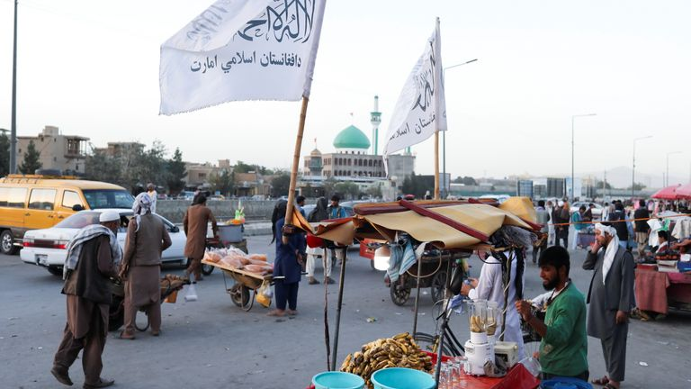 The Taliban flags are seen on a street in Kabul, Afghanistan