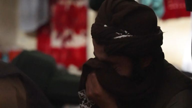 One of the Talibs starts crying and wiping his eyes