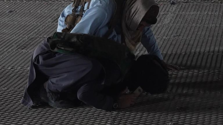 Some of the Taliban militants drop to their knees to pray