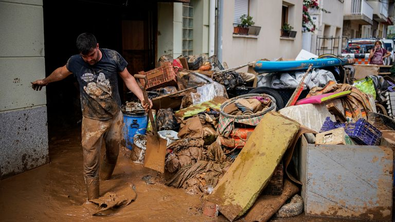 A man cleans up mud after flooding in a seaside town of Alcanar, in northeastern Spain, Thursday, Sept. 2, 2021 PIC:AP