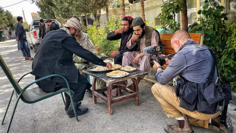 A group of Taliban sharing a meal