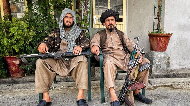 A pair of Taliban fighters with weapons