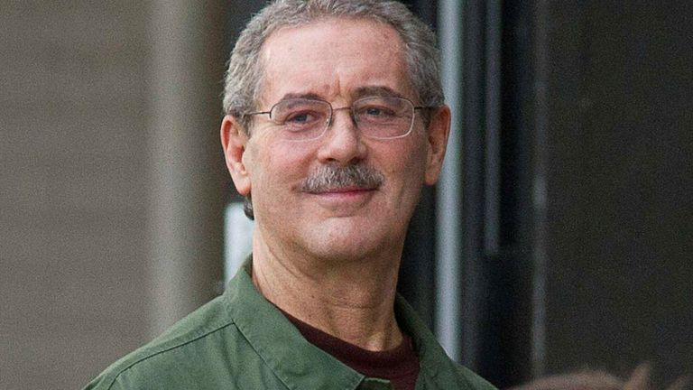 Allen Stanford smiles as he waits to enter the Federal Courthouse in Houston March 6, 2012