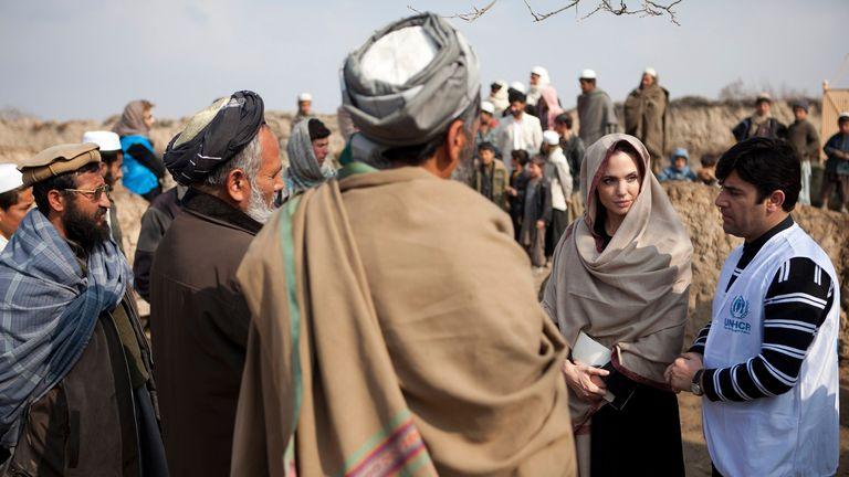 Jolie is pictured in Qala Gudar village near Kabul in March 2011