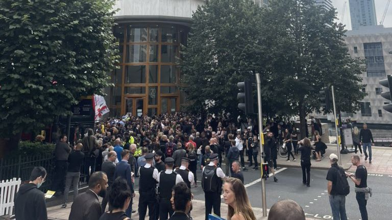 Crowds form outside the MHRA headquarters in central London