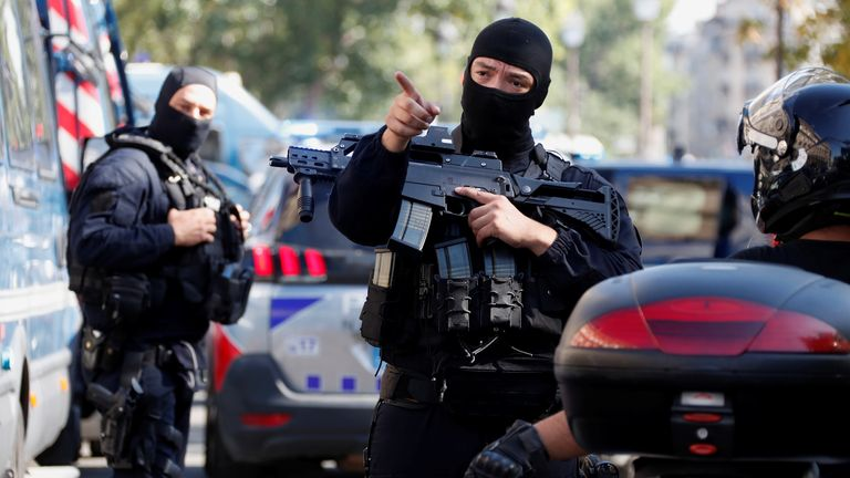 French police forces are seen near the Paris courthouse on the Ile de la Cite ahead of the opening of the trial of the November 2015 Paris attacks in Paris, France, September 7, 2021. Twenty defendants will stand trial over Paris' November 2015 attacks