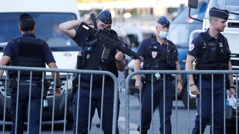 French Police forces secure near the Paris courthouse on the Ile de la Cite France before the start of the trial of the Paris' November 2015 attacks, in Paris, France, September 8, 2021. Twenty defendants will stand trial over Paris' November 2015 attacks from September 8, 2021