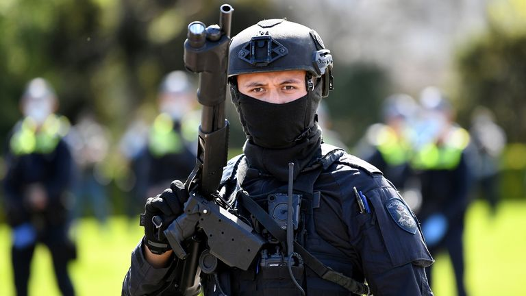 Riot police respond to protesters rallying against construction industry COVID-19 mandates in Melbourne