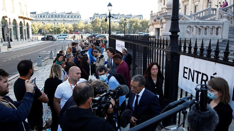 Journalists line up to enter the Paris courthouse on the Ile de la Cite before the start of the trial of the Paris' November 2015 attacks, in Paris, France, September 8, 2021