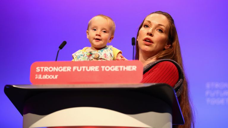 Delegate Catherine Atkinson speaks as she carries her 9-month-old Elena, during Britain's Labour Party annual conference, in Brighton, Britain, September 28, 2021. REUTERS/Hannah McKay