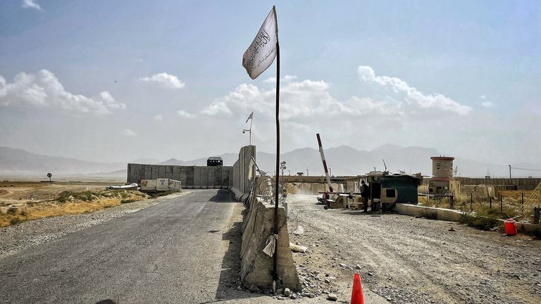 The Taliban flag flies on a checkpoint at the entrance to Bagram