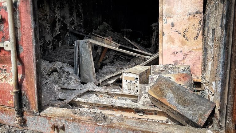 Burned out hard drives and documents are seen at the facility