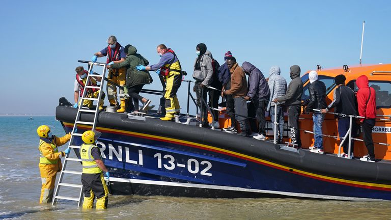 A group of people thought to be migrants are brought ashore from the local lifeboat at Dungeness in Kent, after being picked-up following a small boat incident in the Channel. Picture date: Tuesday September 7, 2021.