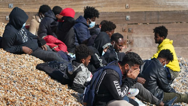 A group of people thought to be migrants are escorted to shore in Kingsdown, Kent, after being intercepted by an RNLI crew following a small boat incident in the Channel. Picture date: Tuesday September 7, 2021