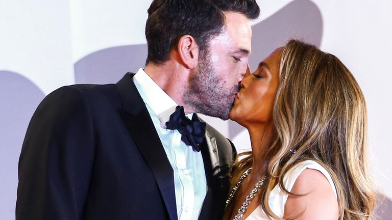 The couple share a kiss after arriving at the 78th Venice Film Festival